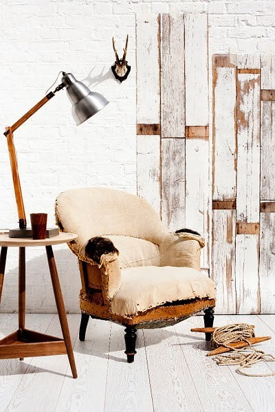 whitewashed wood plank walls with revealed parts broken like chair wooden side table with industrial table lamp