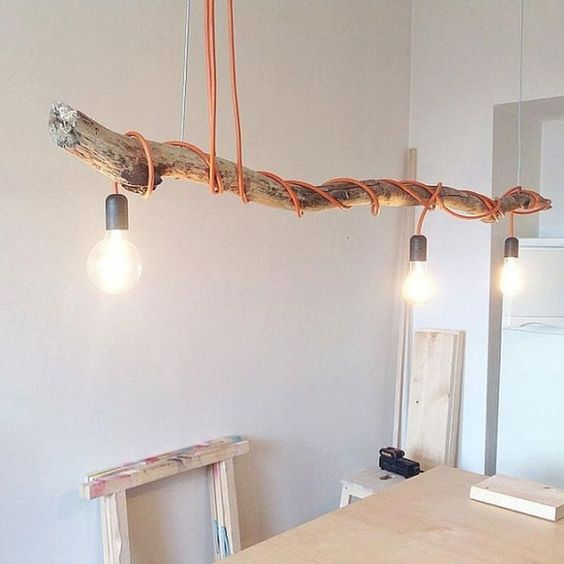 DIY tree trunk lamp with twisted cable and three bulbs