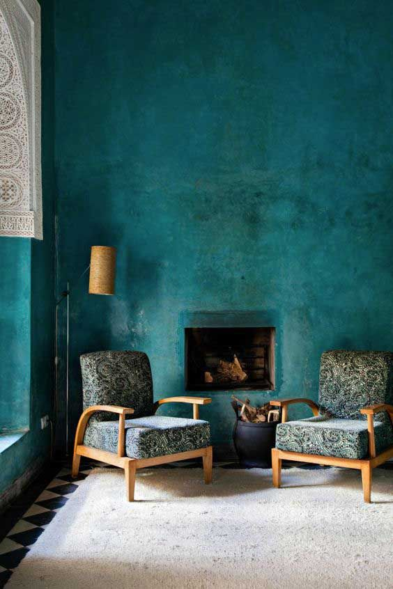 Marrs Green wall paint color in rustic style recessed fireplace a pair of armchairs with wooden frame