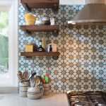 Cement Tiled Backsplash In Colorful Geometric Patterns Dark Wood Open Shelves White Cabinets And Kitchen Countertop