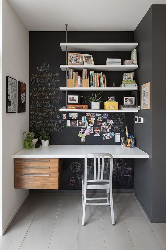 chalkboard wall hanging book shelves white floating desk with additional drawer system white chair
