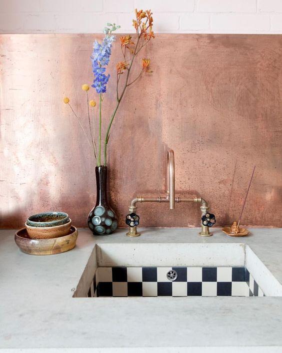copper backsplash whitewashed countertop deep farmhouse sink in monochrome copper faucet