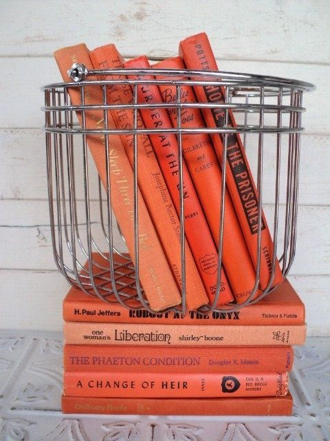 coral colored books metallic basket