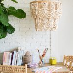 Creamy White Bead Pendant Chandelier With Metal Chains White Brick Wall Rattan Chairs