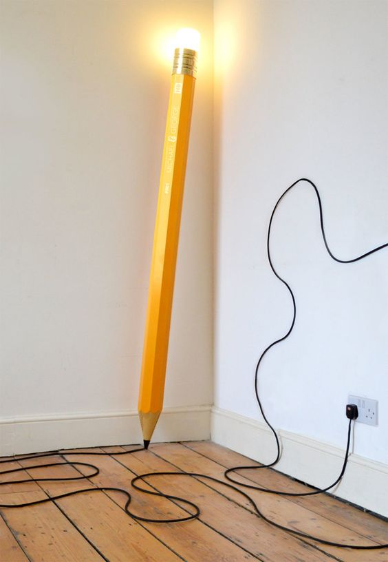 creative floor lamp shaped in giant pencil with power cord on pencil's tip and LED on pencil's eraser