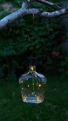 creative outdoor lighting idea made of glass bottle with tiny string lamps