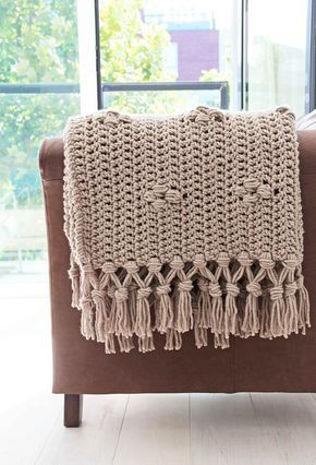 crochet throw blanket with pebble stone patterns