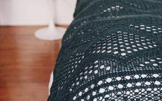 crochet throw in black white bed linen