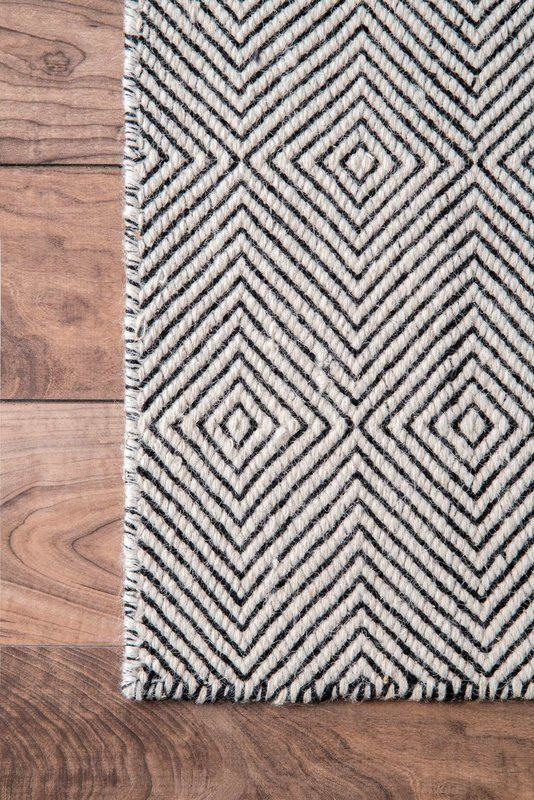 diamond cut hand tufted wool cotton area rug in black and white