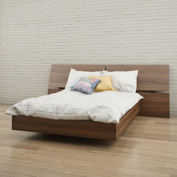 floating platform wood bed frame with extra wide wood headboard white bedding treatment