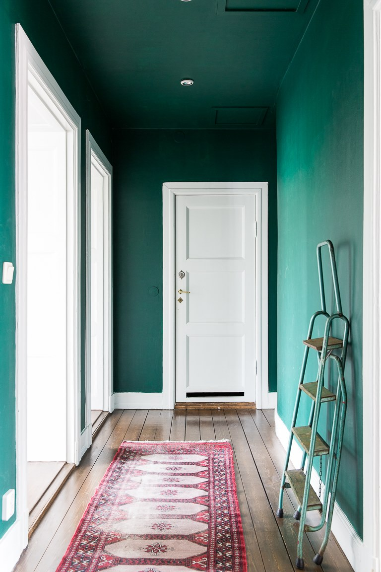 fully Marrs Green wall paint color white door wood plank floors vintage runner