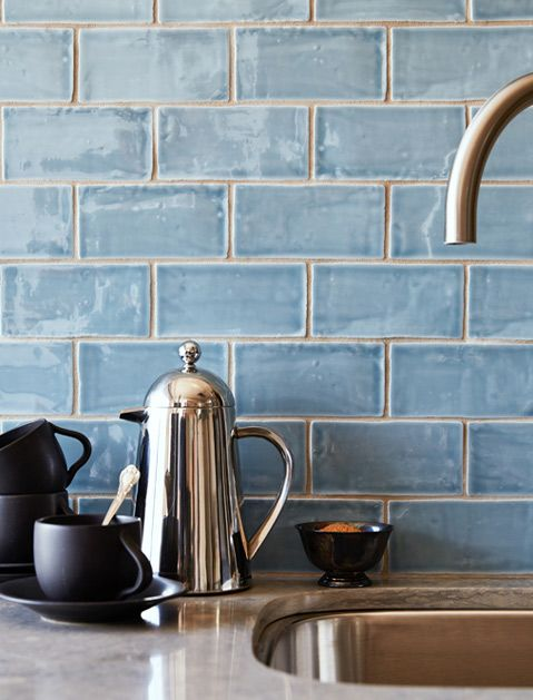 glazed clay tiles backsplash in aquatic blue stainless steel water pot black matte cups