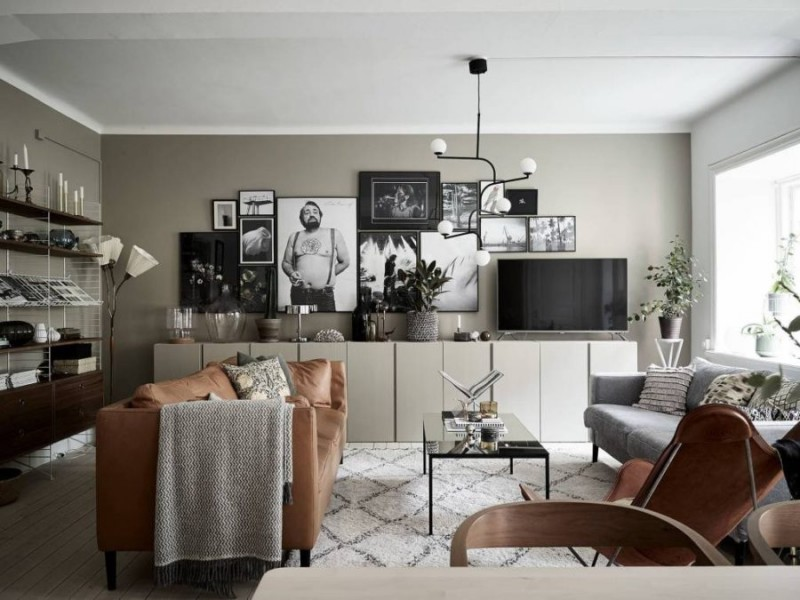 gray wall paint color white ceilings scandinavian area rug leather sofa flat media console table