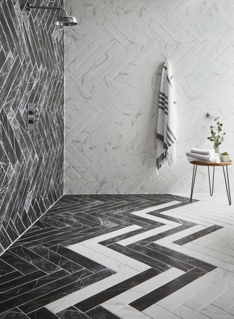 gray white marble like metro tile walls in herringbone shape