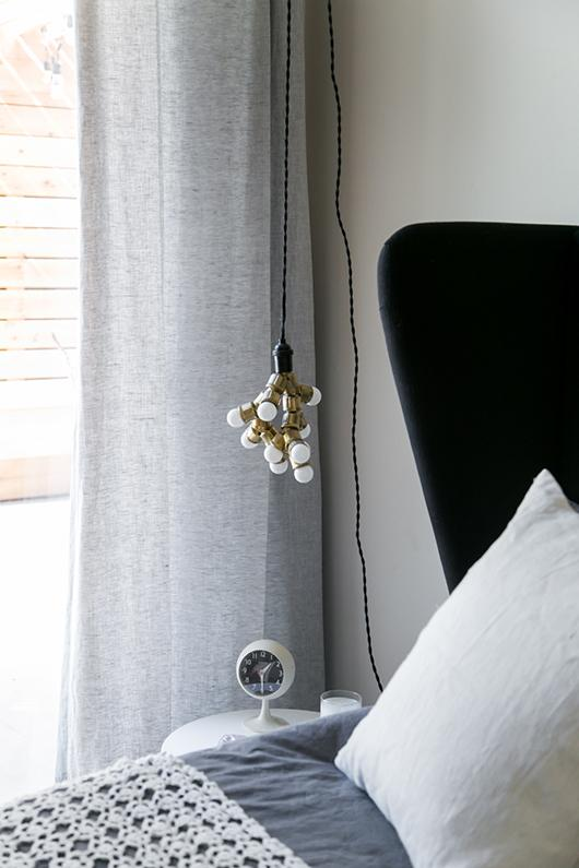 hanging lamp consisting of a cluster of little bulbs with a single lamp fitting