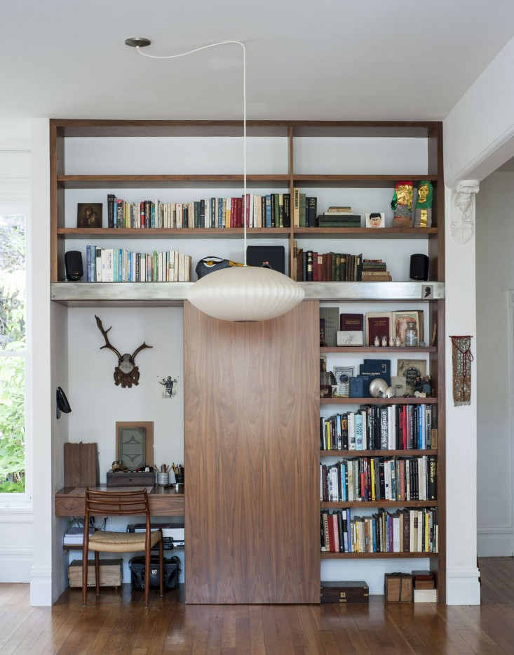 huge wooden bookshelves featuring the home office