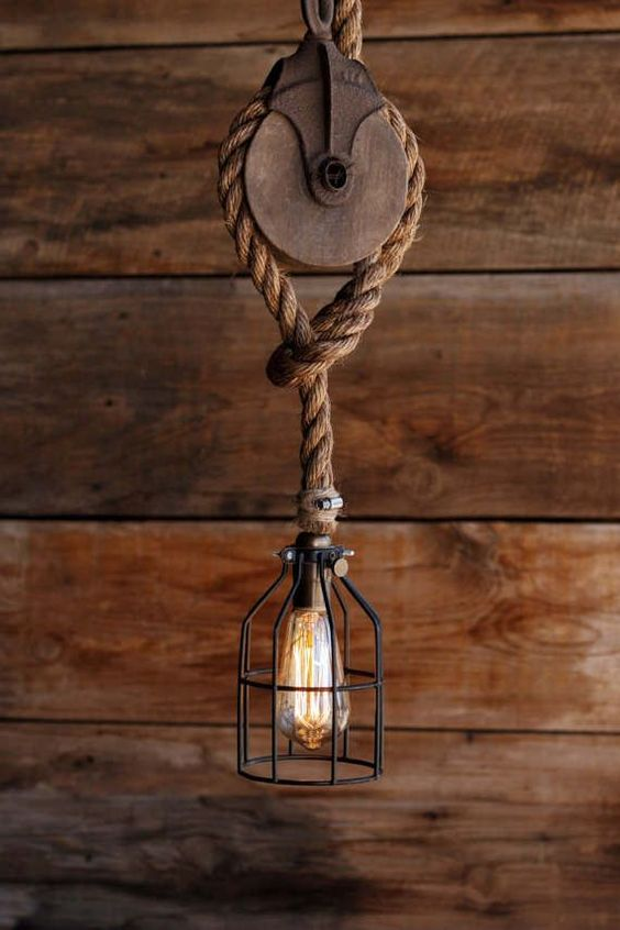 industrial rustic pendant design with black wrought iron cage Manila rope and wood wheel decoration