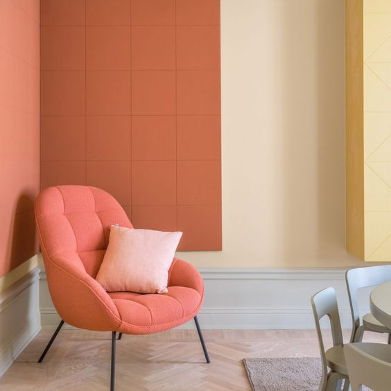 living coral lounge chair with blush pink throw pillow terra coral walls