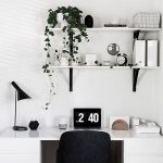 Minimalist Home Office Open Shelving Units In White With Black Supports White Working Desk Black Working Chair With Wood Legs Potted Greenery