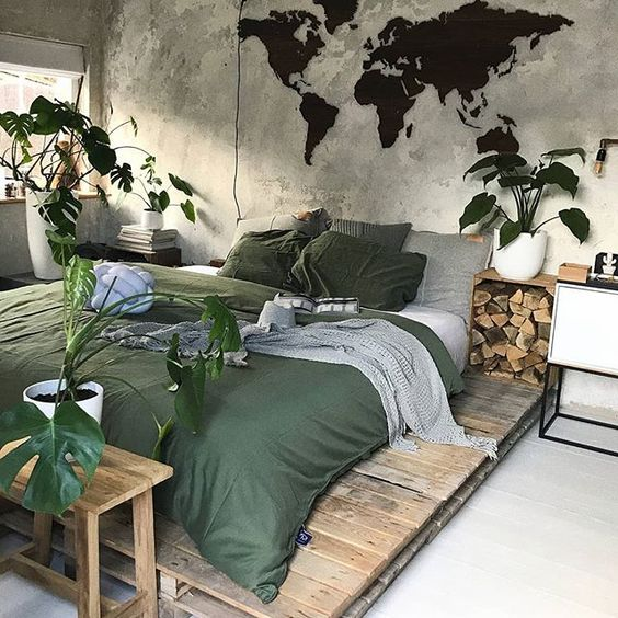 natural green duvet cover and shams platform bed frame wooden side table concrete walls without finishing potted greenery