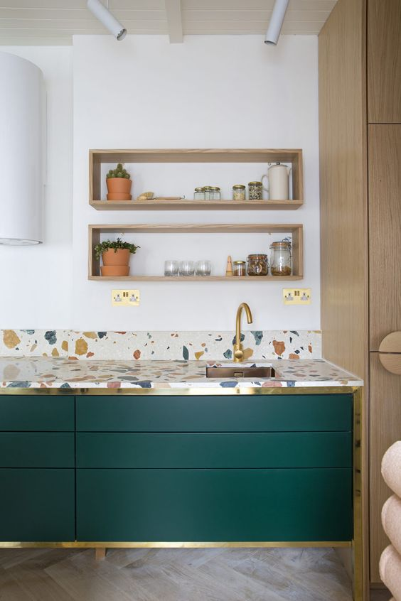 open wooden shelves kitchen cabinets with flat Marrs Green doors with gold toned frame backsplash and countertop with irregular shaped accents