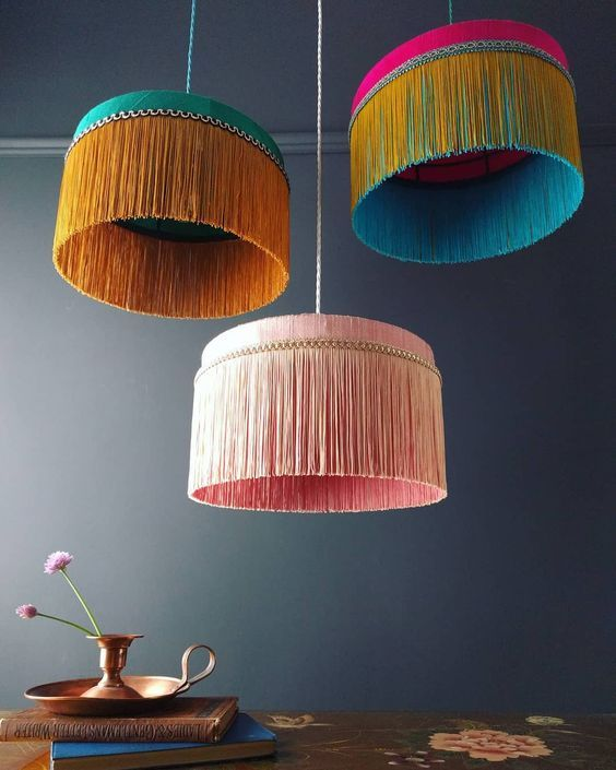 oversized pendants with vivid color hair like draperies