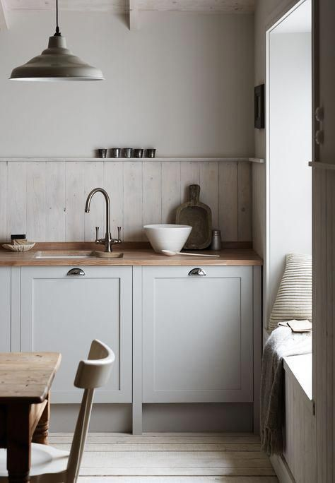 soft neutral kitchen design whitewashed wood plank backsplash wood countertop white kitchen cabinets