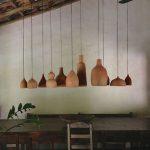 Soft Neutral Pendant Arrangement Dark Wood Dining Furniture Set Exposed Wood Beams And Ceilings