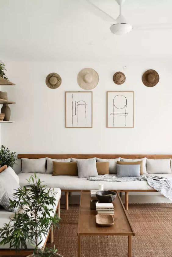 teak daybed with white cushion and throw pillows teak coffee table woven area rug whitewashed walls