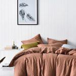 Terracotta Bedding Treatment Crisp White Wood Plank Walls Crisp White Floors Black Framed Floral Painting