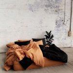 Terracotta Duvet Cover Black Duvet Cover Terracotta Pillows Black Pillows Whitewashed Brick Walls Light Wood Plank Floors