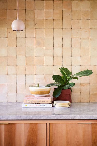 terracotta tiled backsplash blush pendant wood cabinets marble countertop