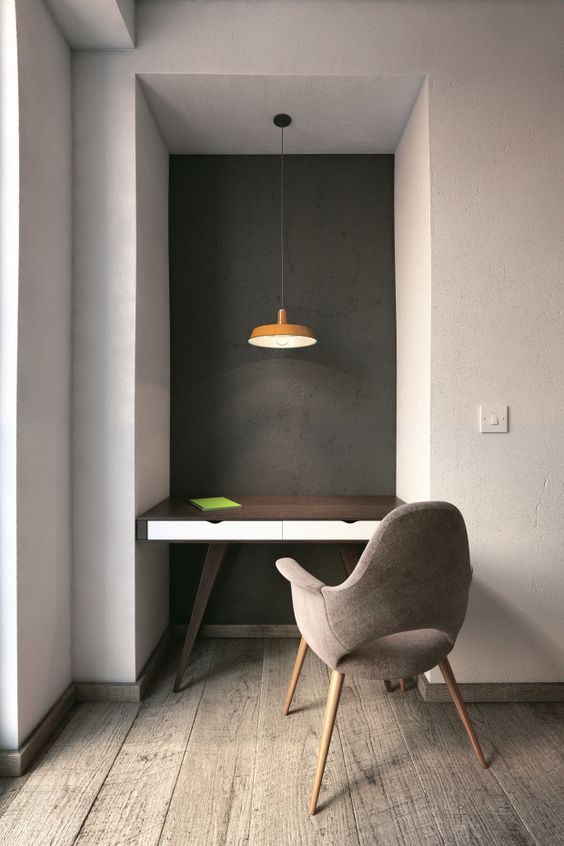 ultra minimalist home office with midcentury modern desk and chair pendant with orange lampshade