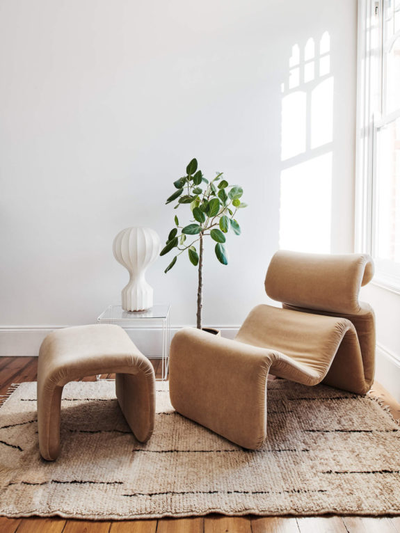 uncommon shaped lounge chair in cream woven rug