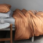 White Bed Linen And Pillow Terracotta Duvet Cover And Pillow Round Marble Top Bedside Table With Wood Frame