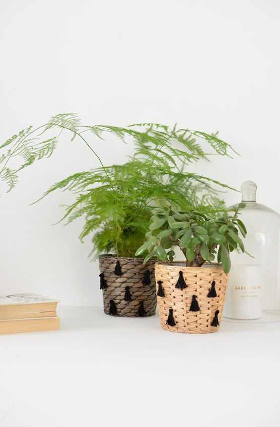 wicker planters with black tassels as the ornaments