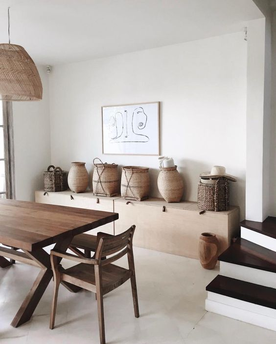 wooden display table with some woven jugs and baskets wood dining table wood dining chairs