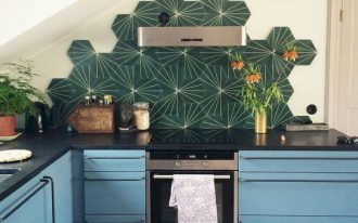 Boho tiled backsplash in bold emerald black kitchen countertop blue kitchen cabinets stainless steel utensils