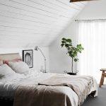 Attic Bedroom Idea Slanted Wood Plank Ceilings Potted Houseplants White Window Curtains