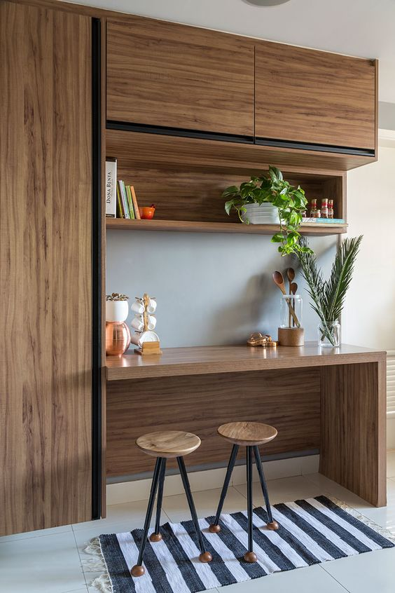 breakfast nook design wood bar table integrated with cabinet open shelf and closet a couple of bar stools with round wood top striped white black runner