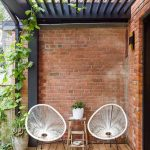 Brick Walls Heavy Metal Ceilings And Pillar In Black Wood Plank Floors A Couple Of Egg Chairs DIY Side Table For Greenery