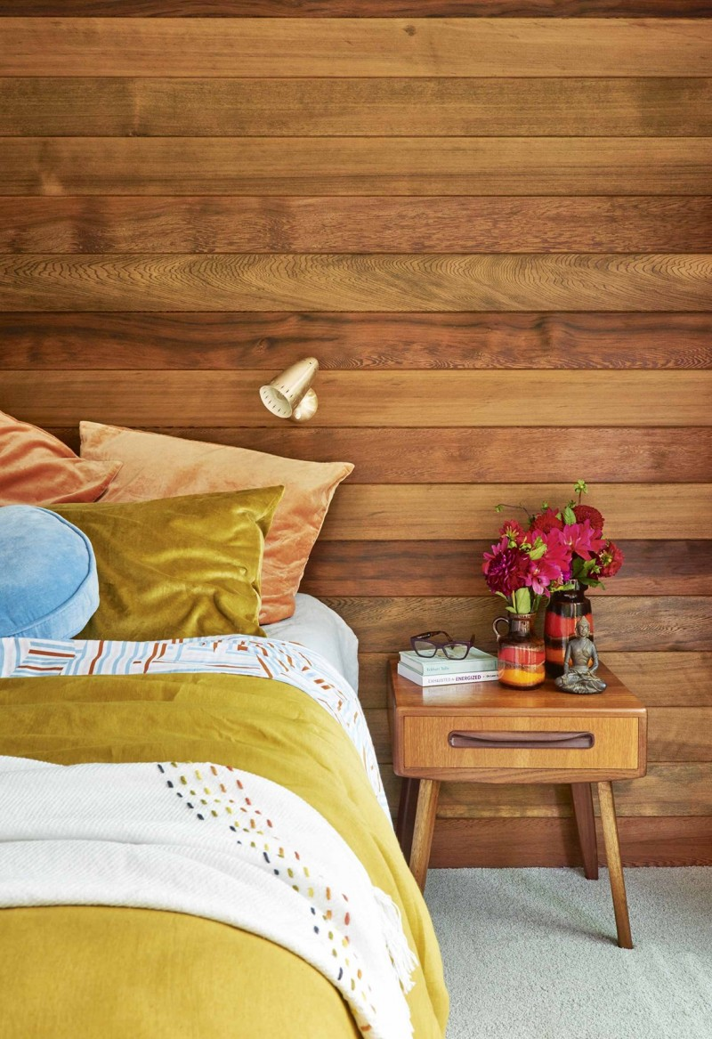 cedar cladding wall without finishing midcentury modern bedside table made of natural cedar multicolored bedding treatment