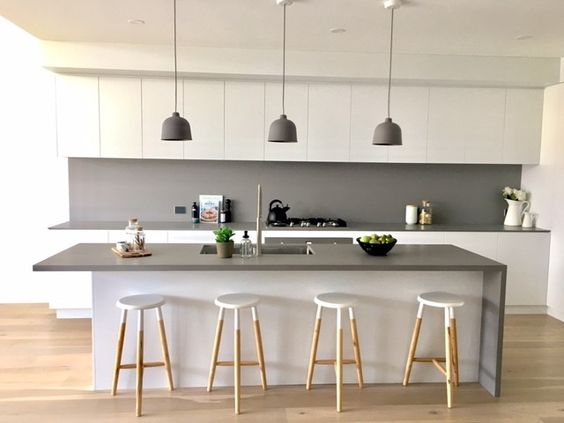 clean line kitchen cabinets in white gray benchtop light wood stools with white accent on top gray backsplash gray pendants