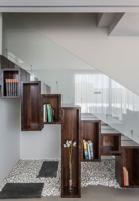 contemporary stairs with clear glass railing system recessed open shelves under the stairs