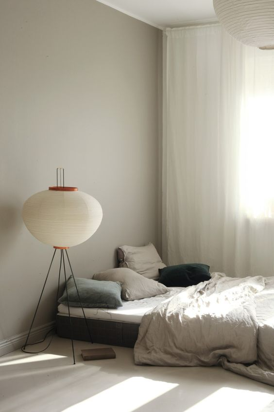 floor bed design white comforter pure white curtains floor lamp with tripod legs and lantern lampshade in white