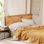 Floor Bed With Headboard Addition Yellow Blanket Broken White Bed Linen And Pillows Floor Bookshelf Made Of Wooden White Brick Walls Wood Plank Floors