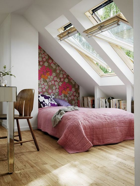 girls attic bedroom colorful flower wallpaper pink duvet cover a couple of skylights wood floors
