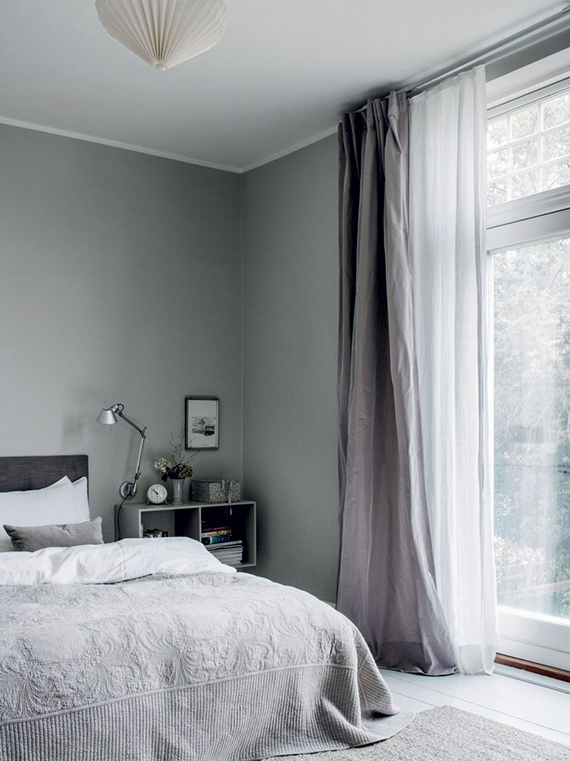 gray walls and ceilings bed frame with matte black headboard floating cubic nightstand double layered curtains in white and gray