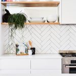 Herringbone Patterned Subway Tile Backsplash In White With Black Grouts