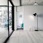 Huge Glass Panel And Door Bare Concrete Ceilings Wood Plank Floors White Walls Modern Floor Lamp